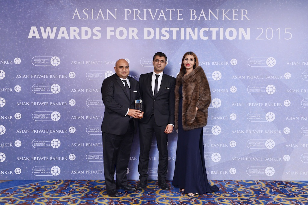 Ronak Sheth and Rakesh Asrani from IIFL Private Wealth Management receives the award for Best Domestic Private Bank - India