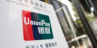 a sign on a store window for Union Pay Chinese credit cards, in a store in Tokyo, Japan, Thursday 7t